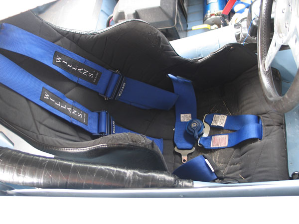 ButlerBuilt seat and Willans 6-point cam-lock safety harness.