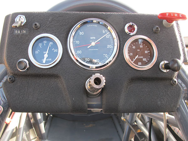 Stewart Warner coolant temperature gauge (100-240F) and oil pressure gauge (5-100psi).