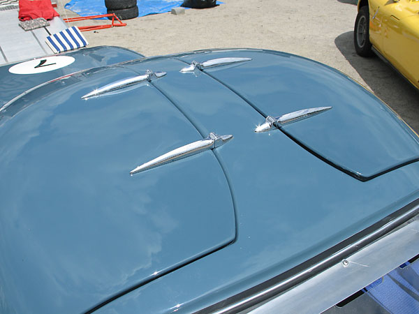 Marcos gull-wing door hinges.