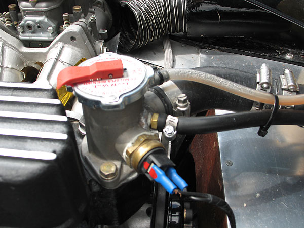 Thermostat housing with filler cap.