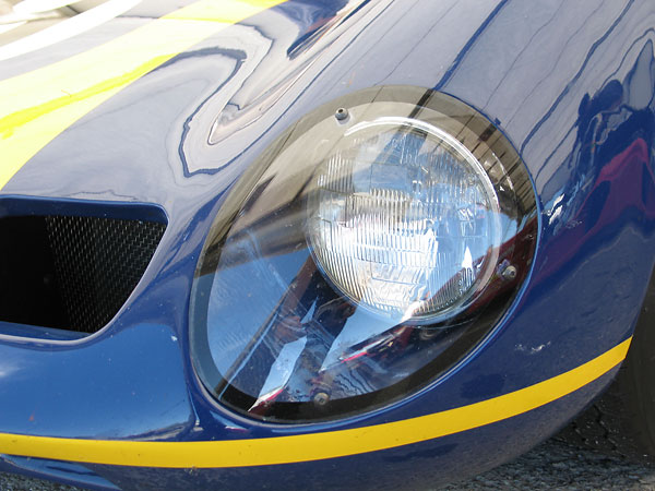Perspex headlamp cover.
