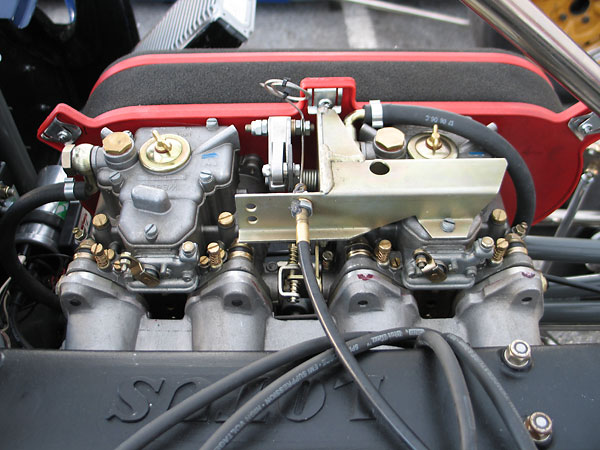 Dual Weber 45DCOE carburetors and Weber TLK1/W throttle linkage assembly.