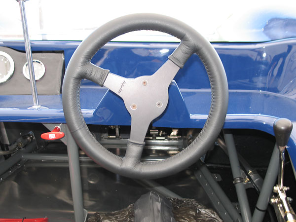 Moto Lita leather wrapped aluminum steering wheel.