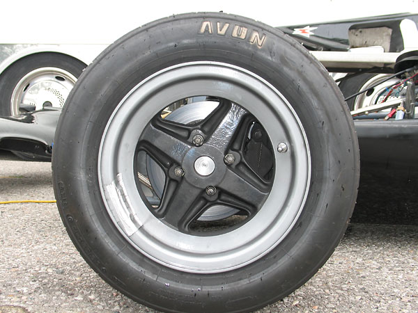 Brabham style 4-spoke magnesium wheels.