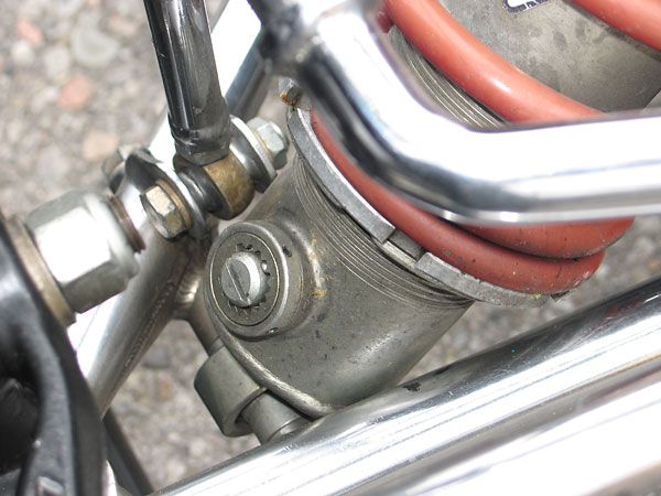 Compression adjuster at the bottom of the shock absorber.