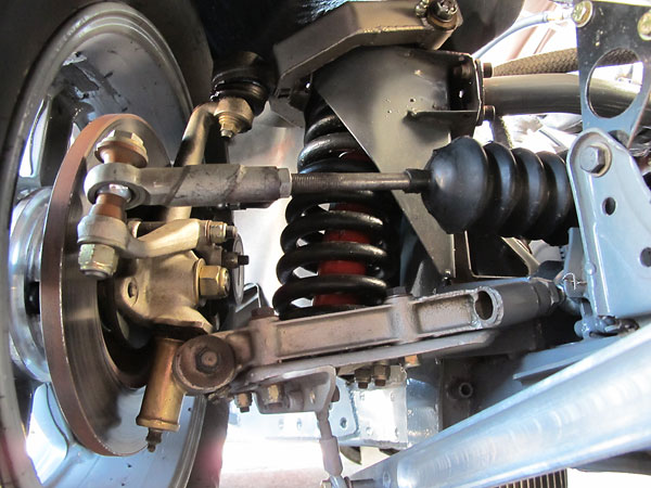 Stock lower control arms modified with Heim joints on inboard side for adjustability.