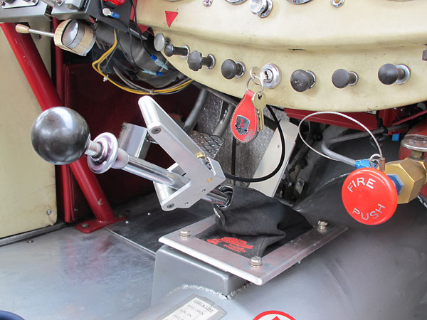 Hand-operated throttle mechanism to help him match engine-transmission revs.