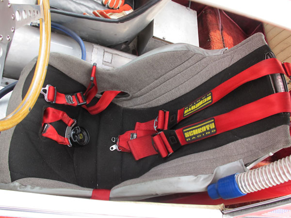 Schroth six point cam-lock safety harness.