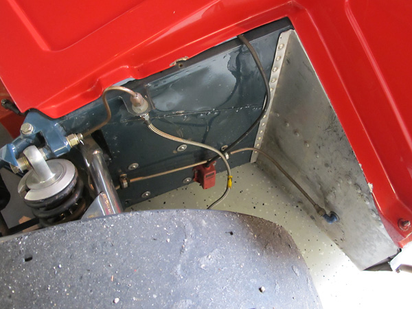 The Chevron B21 footbox and pedals are set behind the centerline of the front wheels.