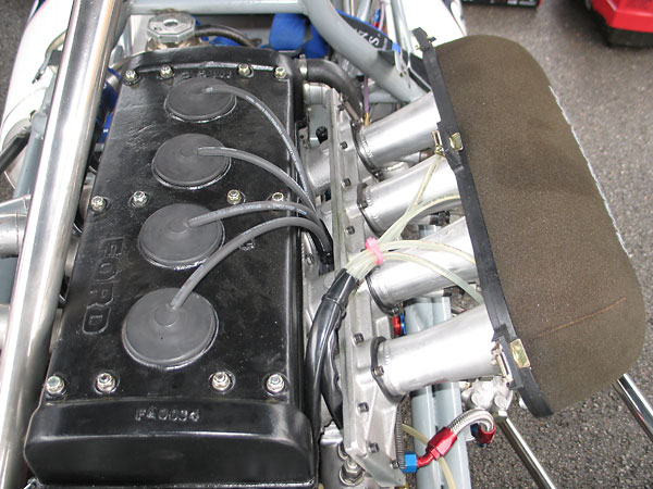 Lucas mechanical fuel injection. The injectors are located just upstream of the throttle slides.