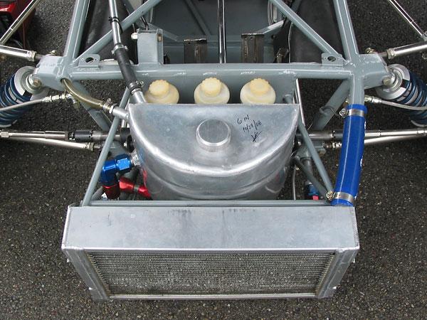 Nose-mounted aluminum engine oil reservoir tank.
