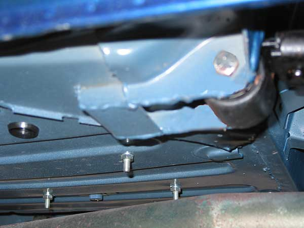 Reinforced (buttressed) leaf spring mounting