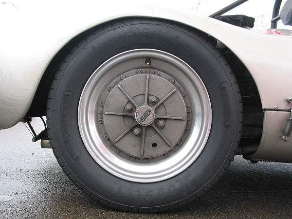 Dunlop Racing CR48 4.50L-15 (front) and Hoosier Vintage TD 5.00-15 (rear) tires.