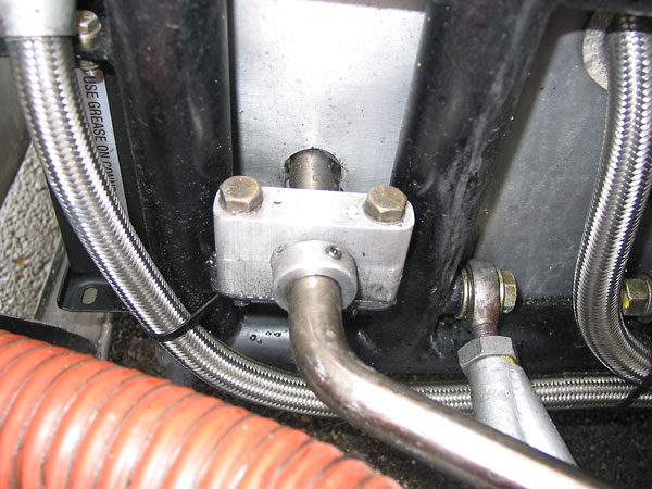 The front anti-roll bar is supported by these simple aluminum pillow blocks.