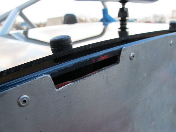The flat tabs slide neatly into small slots, which have been cut into the car's bodyshell.