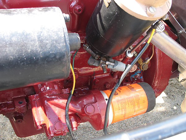 A spin-on oil filter adapter facilitates use of a Fram oil filter.