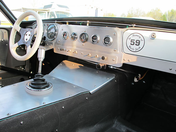 A valve mounted at the lower edge of the dashboard is for adjustment of front-to-rear brake balance.
