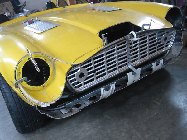 The headlamp buckets were moved approximately six inches rearward from the stock TVR 2500M position.