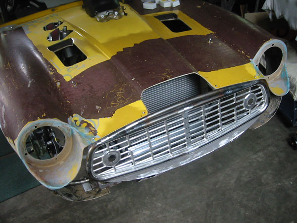 Whoa! Just hours ago Dennis must have decided that the Triumph TR3A grille works better upside down.