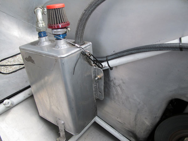 Custom fabricated aluminum overflow/breather tank.