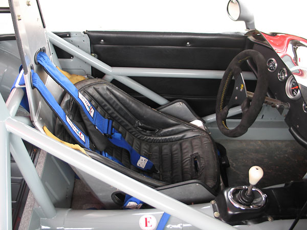 ButlerBuilt aluminum seat. Teamtech Motorsports Equipment safety harness.