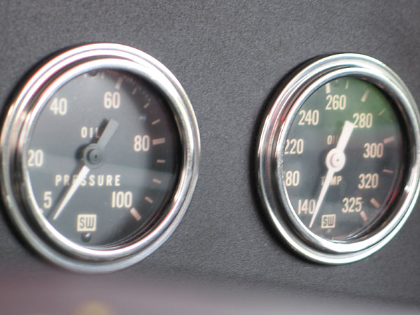 Stewart Warner oil pressure (5-100psi) and oil temperature (140-325F) gauges.