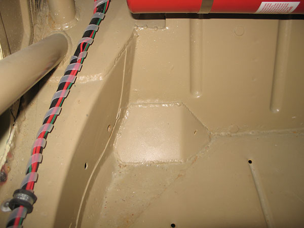floor was also reinforced above the forward leaf spring mounts