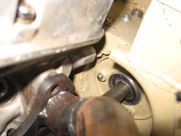Steering shaft bearing-support firewall passthrough.