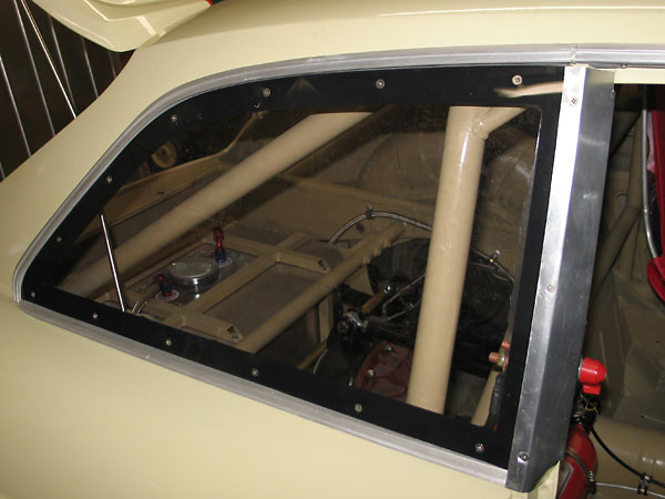 Aluminum spacers align the Lexan three-quarter windows with the door glass.