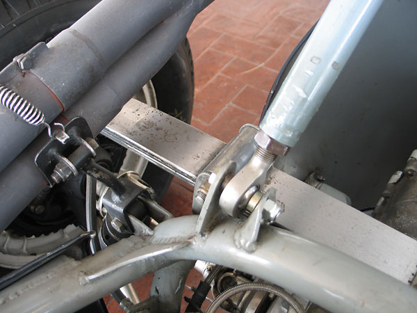 Another view of the muffler bracket, and also the roll-over hoop brace lower attachment point.