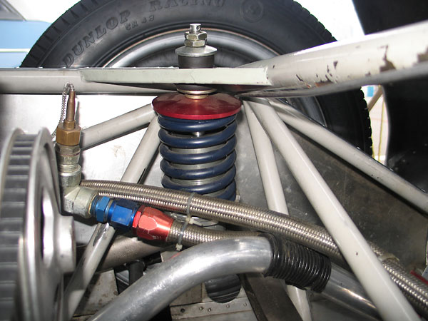 Original Girling coilover shock absorbers have been replaced by KONI units with adjustable valving.