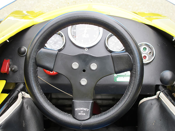 Mountney of Britain leather wrapped steering wheel.