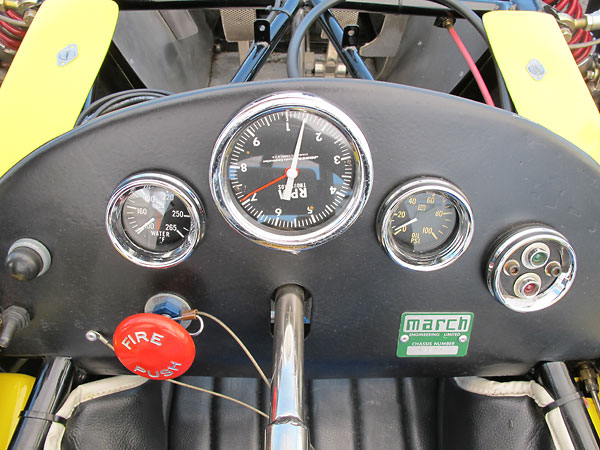 Stewart Warner water temperature and oil pressure gauges, and Jones mechanical tachometer.