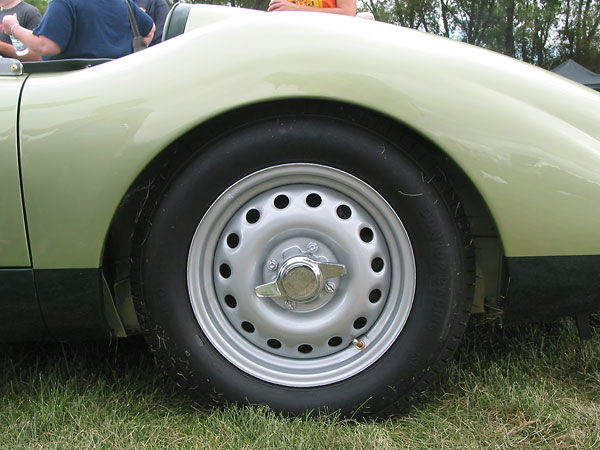 15x5.5 Dunlop peg-drive knock-off steel wheels. Dunlop bias-ply historic racing tires.