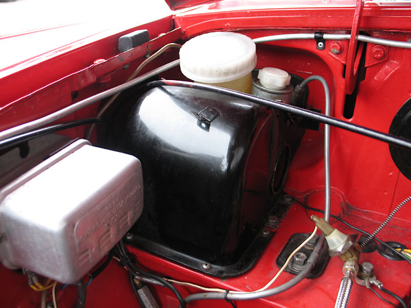 A later model MGB dual-circuit master cylinder has been installed.