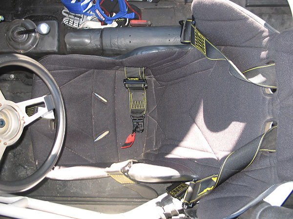 Kirkey aluminum racing seat, and Impact Racing five point latch-and-link safety harness.