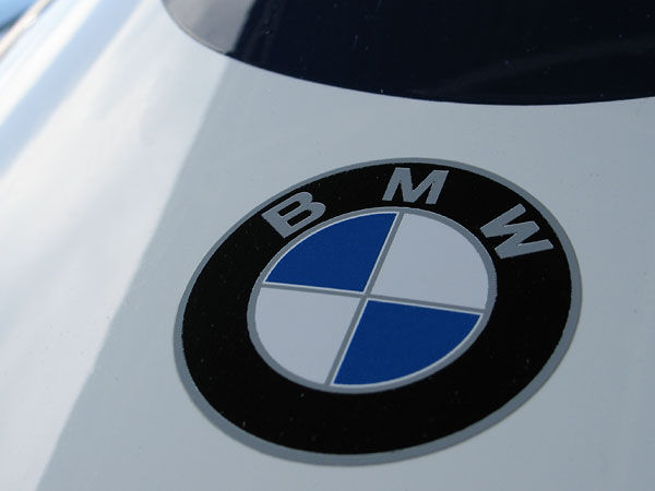 BMW decal, because this racecar is powered by a BMW M12/7 2.0L four-cylinder engine.