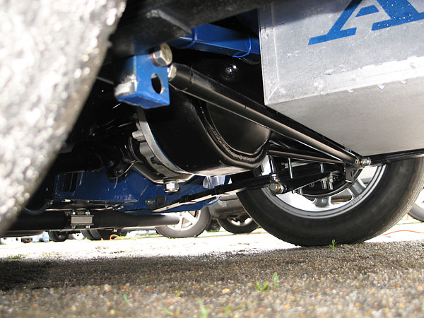 Carrera telescoping shocks, inverted so proportionally more weight is unsprung.