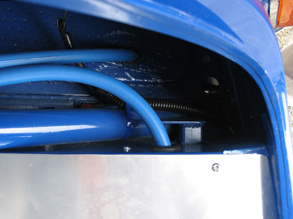 The fuel cell vent line runs up to the top of the roll cage, then back down through the floorboard.