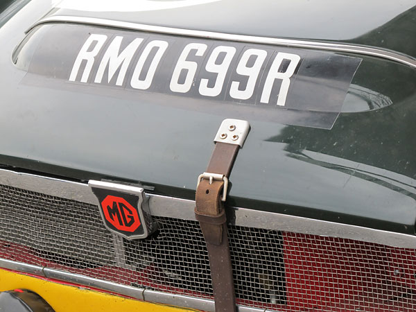 MBL-546E had a leather hold-down strap at the front of its bonnet but RMO-699F didn't.