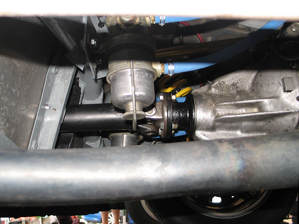 Dual fuel pumps on either side of the driveshaft and the rear suspension's third link.