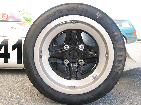 Lotus L122 magnesium alloy racing wheels (13x10 front, 13x14 rear).