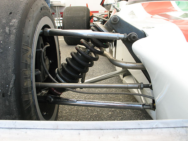 Interestingly, a third member connects the inboard arms of the wishbone yet the anti-sway bar connection comes in at mid-span unsupported.