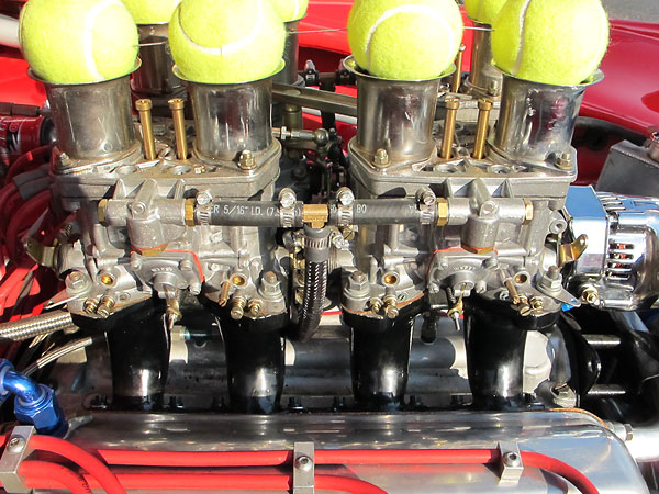 Four Weber 44IDF two-barrel carburetors mounted on custom fabricated intake manifolds.