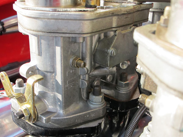 The base of each carburetor is stamped 44 IDF 81 which corresponds to Weber part number 18990.035.