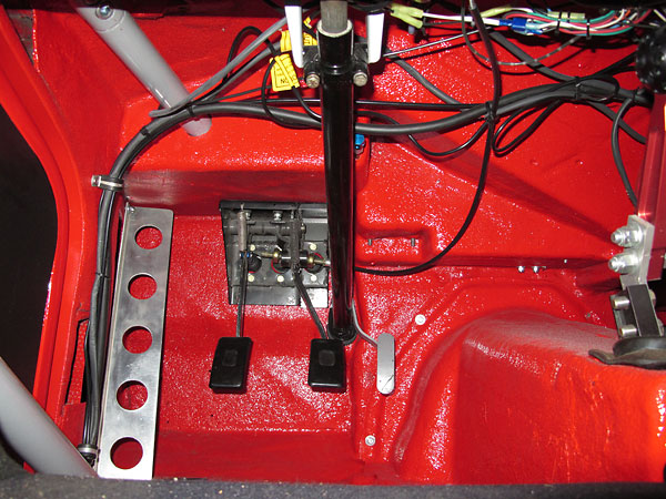 Original Daimler brake pedal assembly has been modified to accommodate dual master cylinders.