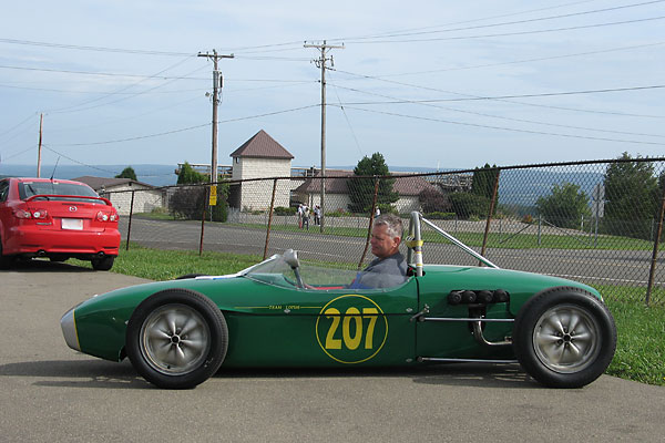 Marcus Jones drives Allen Fine's Lotus 18 Junior Race Car, Number 207