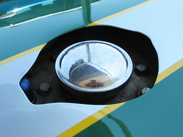 LeMans Style flip-open fuel cap would have been original.