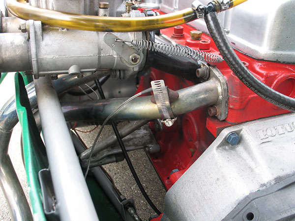 Exhaust gas temperature sensor, mounted to the exhaust header.