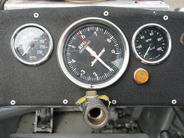 Smiths coolant temp gauge (90-230F), Jones mechanical tach (1000-9000rpm), Smiths oil pressure gauge (0-100psi).